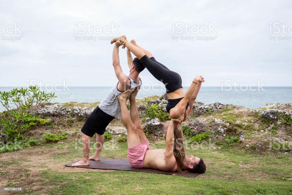 Group Acro Yoga Pose 1 Stock Photo Download Image Now Istock