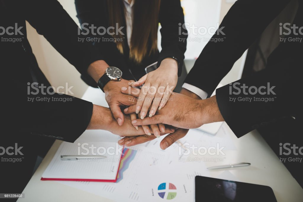 Group Asian Young businessmen join hands for working the job success, Hand coordination, symbolizing the hands to unity and teamwork, meeting, helps , business concept. stock photo