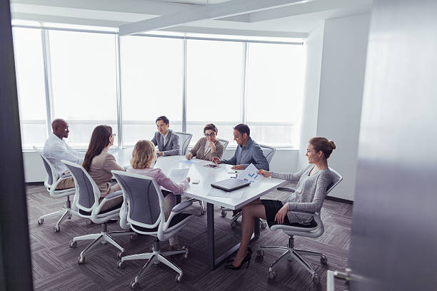 Group business meeting in office conference room Group business meeting in office conference room governing board stock pictures, royalty-free photos & images