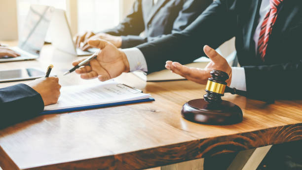 Group business people and lawyers meeting together. Consulting in regard to the various contracts at meeting. Group business people and lawyers meeting together. Consulting in regard to the various contracts at meeting. lawsuit stock pictures, royalty-free photos & images