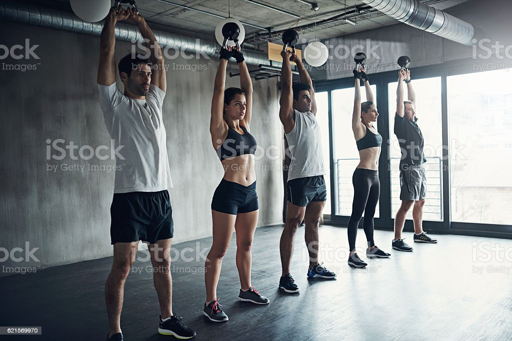 Group classes are carefully paced to make the time fun foto stock royalty-free