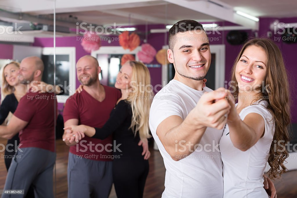 Group dancing in club stock photo