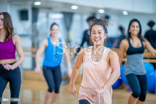 897892972 istock photo Group Dancing 989174684