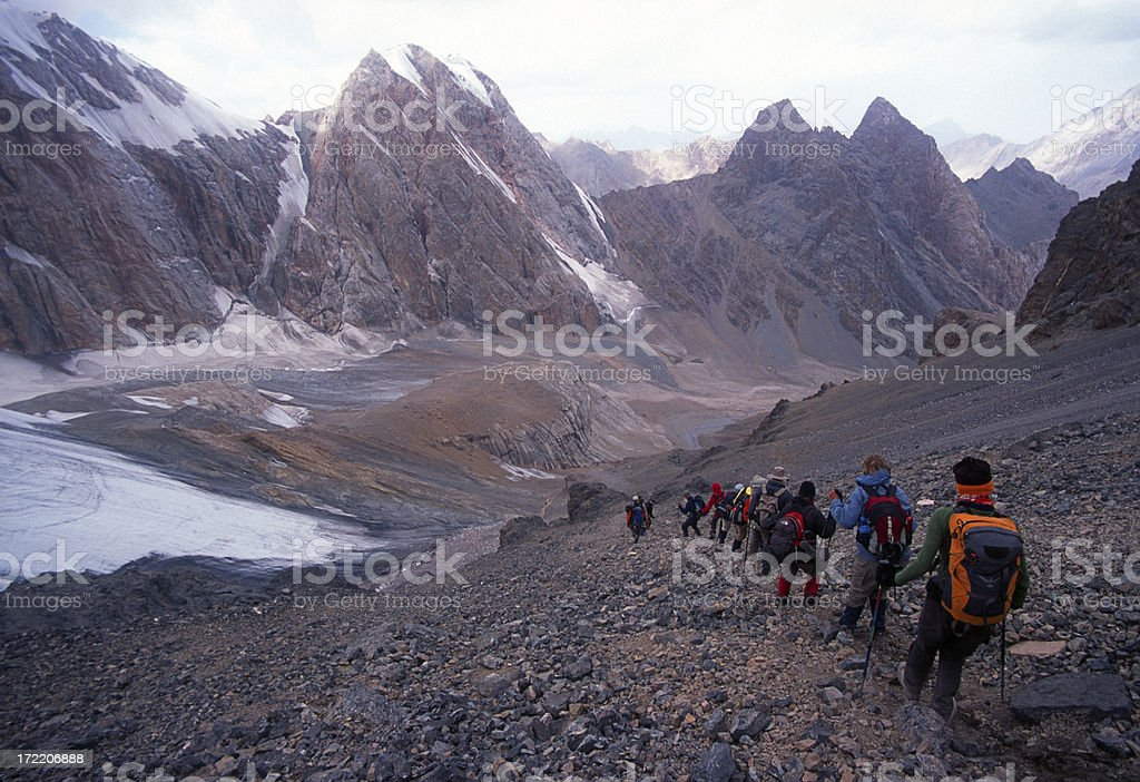 Group descending a steep slope stock photo
