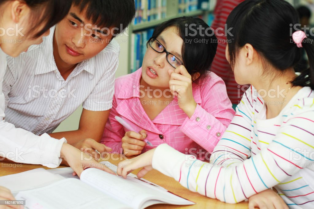 group dicsussion in the library royalty-free stock photo