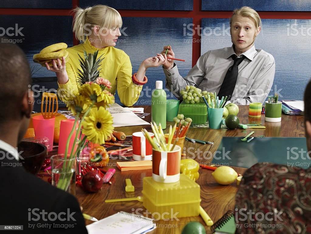 group discussing topic of fruit in the boardroom royalty free stockfoto