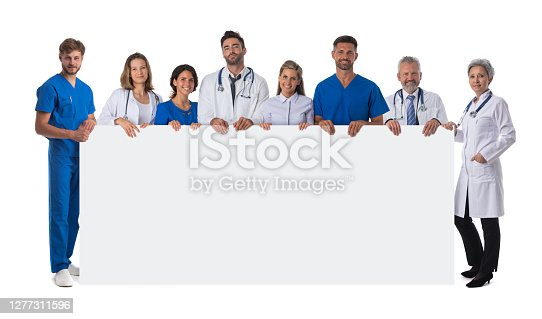 Group of happy multiracial doctors holding blank placard with copy space for text isolated on white background full length portrait
