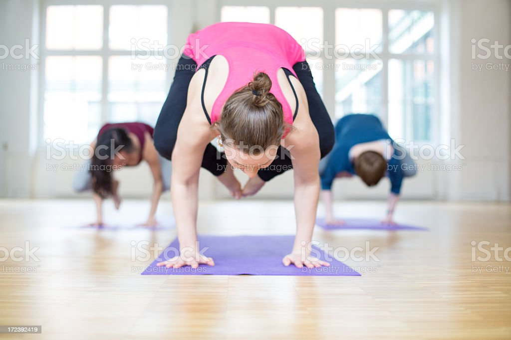 Group doing yoga crow position royalty-free stock photo