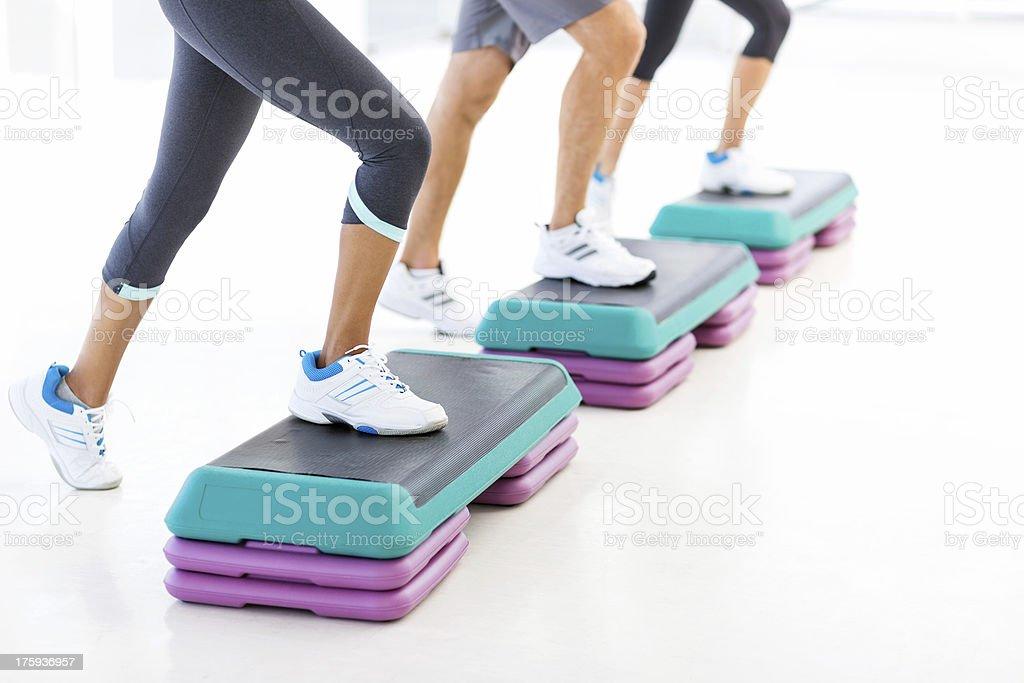 Group Exercising On Steppers In Gym royalty-free stock photo