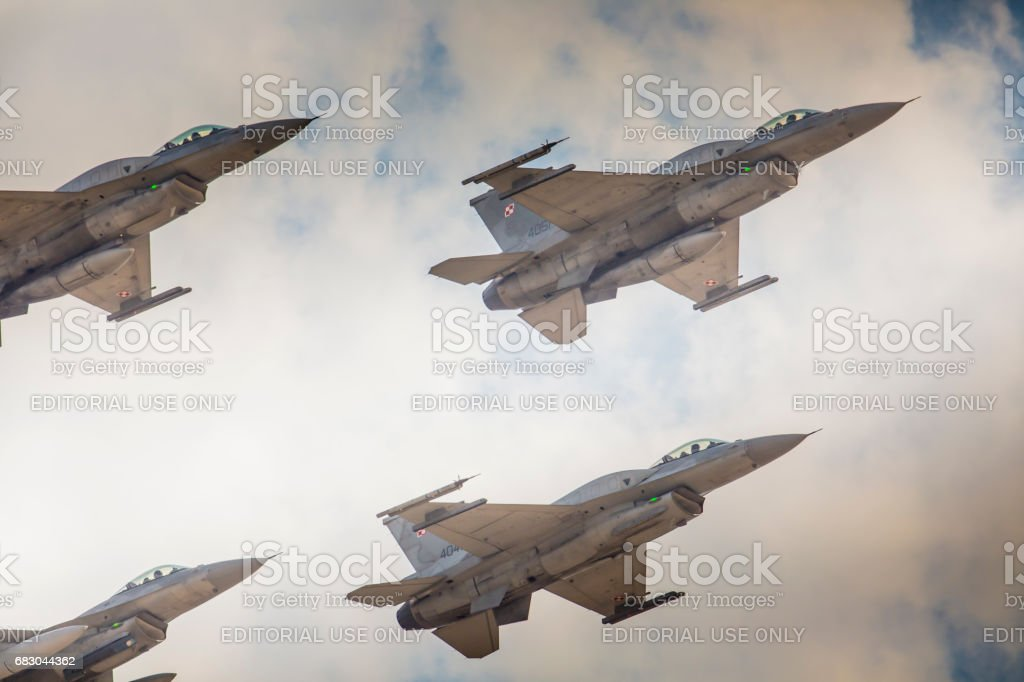 RADOM, POLAND - AUGUST 23:  Group formation 'F-16' at blue sky during at Air Show Radom 2015 event on August 23, 2015 in Radom, Poland stock photo