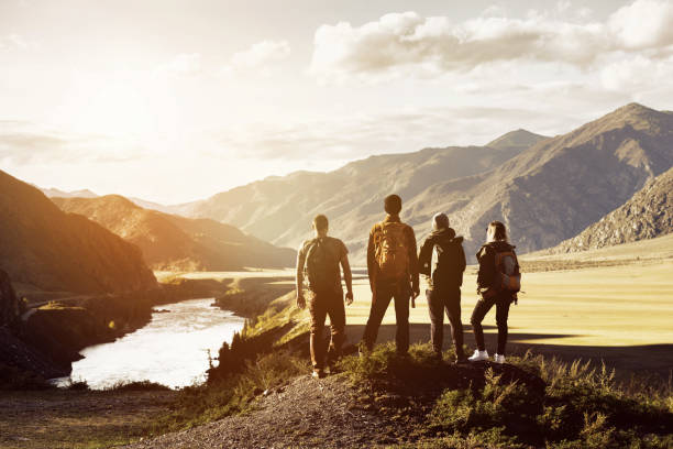 Group four people mountains travel concept - foto stock