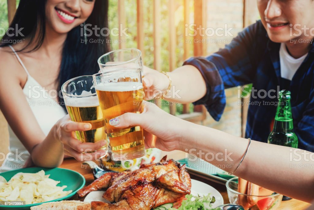 Group friend young asian people celebrating beer festivals happy while enjoying home party stock photo