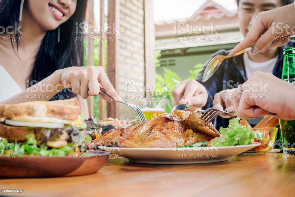 Group Friends young asian people Party and eating food happy enjoying in home stock photo
