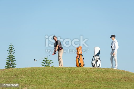 Group golfer sport course golf ball fairway. People lifestyle playing game golf tee of on the green grass. Asian man with friend player game shot in summer. Healthy and Sport outdoor