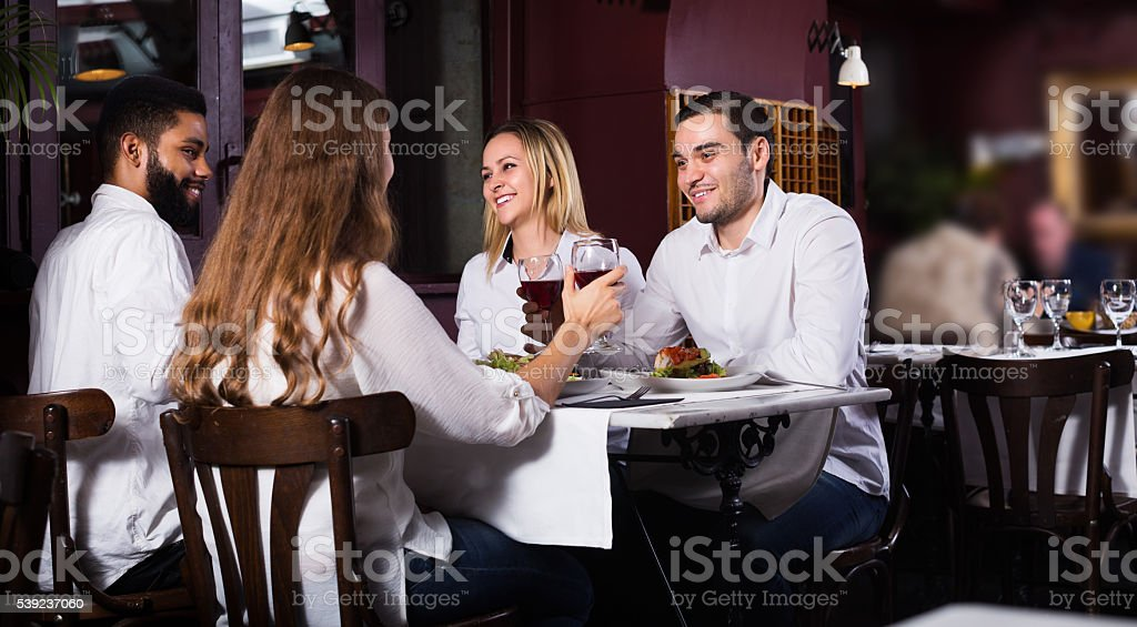 Group having dinner in restauran royalty-free stock photo