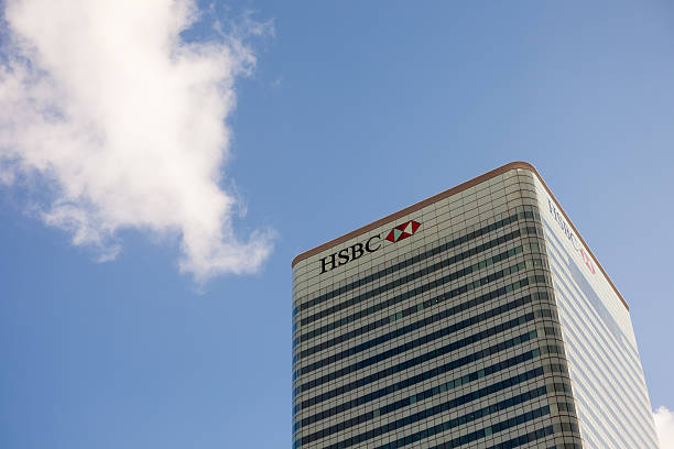 """HSBC Group Head Office Tower in Canary Wharf, London """"London, United Kingdom - Feb 12, 2011: Top of HSBC Group Head Office Tower in Canary Wharf, London. Summer cloudy sky on the back. This is one of the highest buildings in all United Kingdom."""" hsbc stock pictures, royalty-free photos & images"""