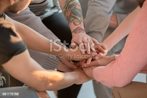 618070568 istock photo Group holding hands together 691775768
