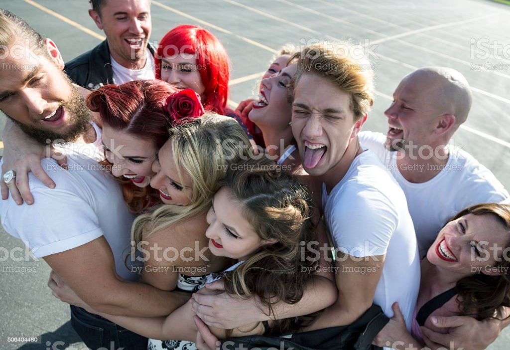 Group Hug at Fifties High School Dance Party stock photo