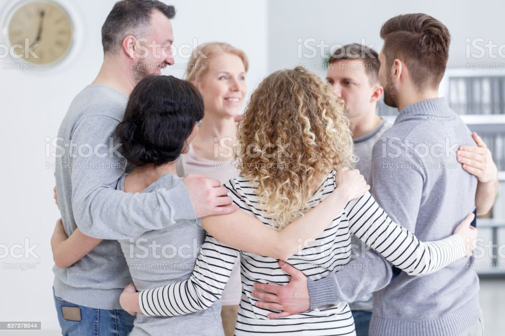 Group hug during therapy stock photo