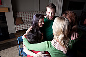 Group hug in mental health counselling session