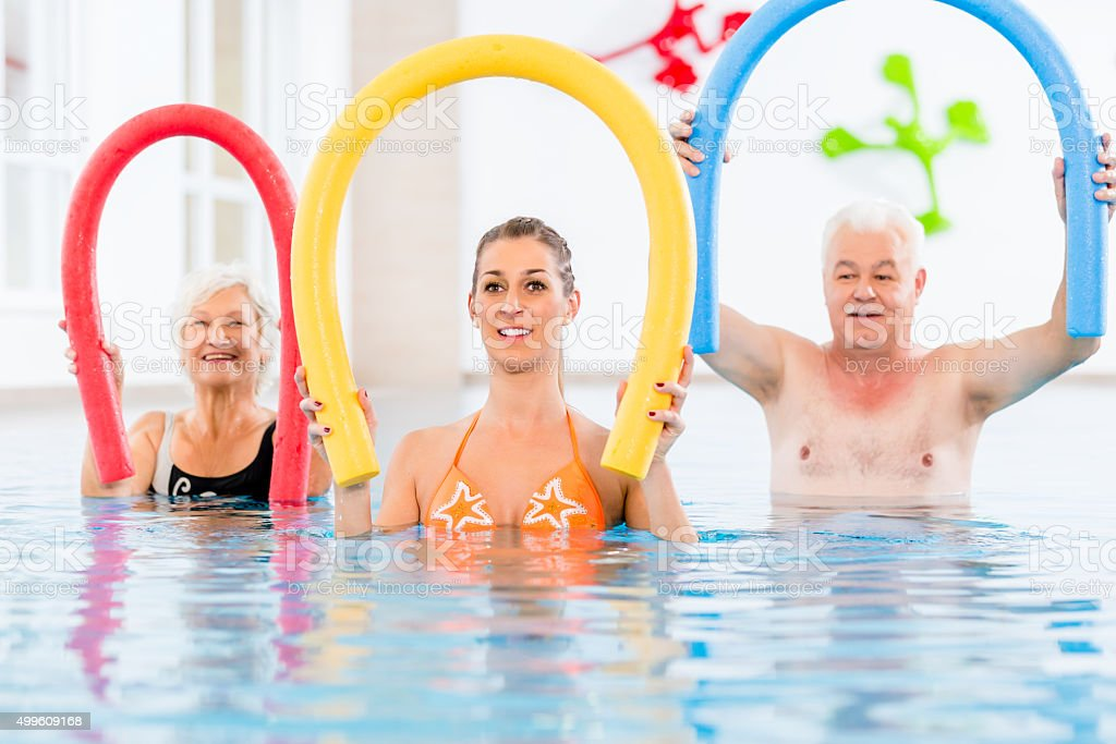 Group in aquarobic fitness swimming pool stock photo