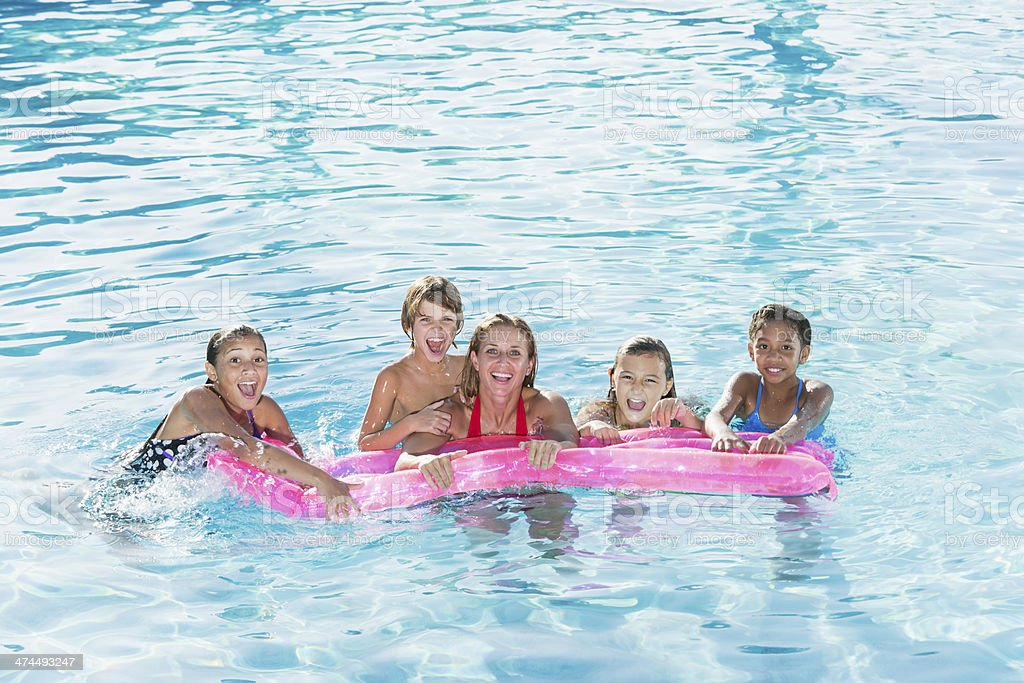 Group in swimming pool stock photo