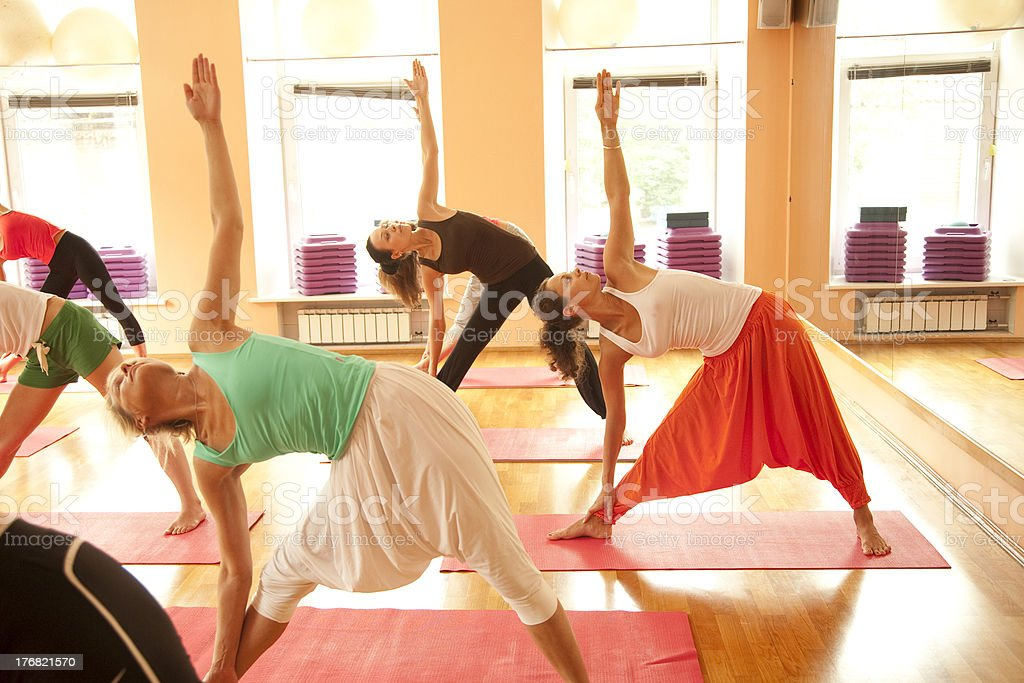 Group in yoga pose royalty-free stock photo