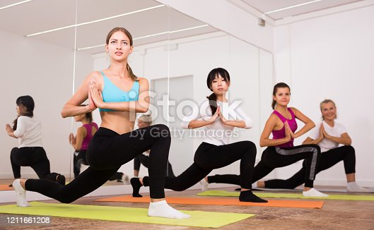 Group lesson on hatha yoga in the studio