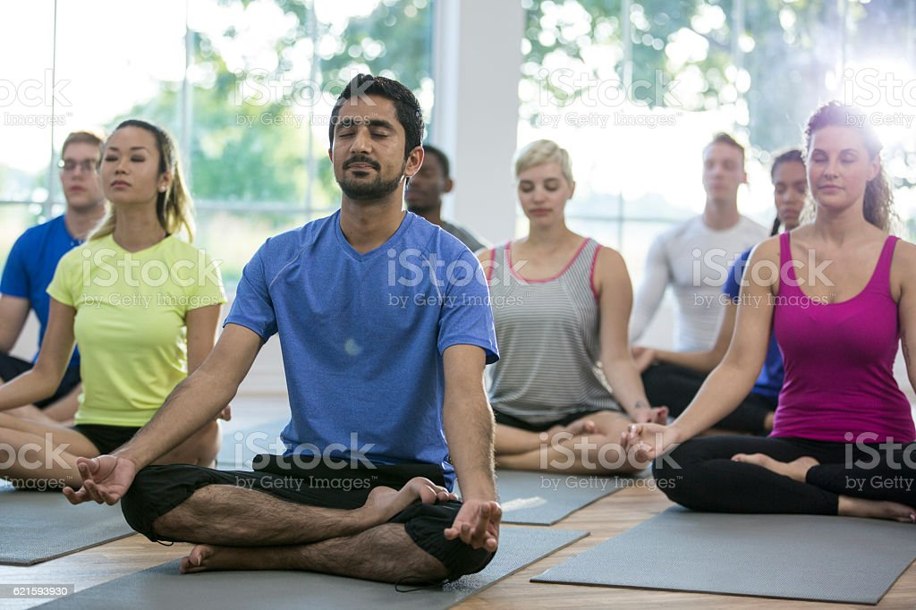Group Meditation in a Yoga Class stock photo