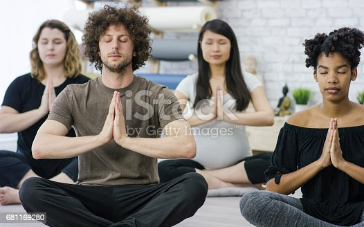 637804152istockphoto Group Meditation 681169280