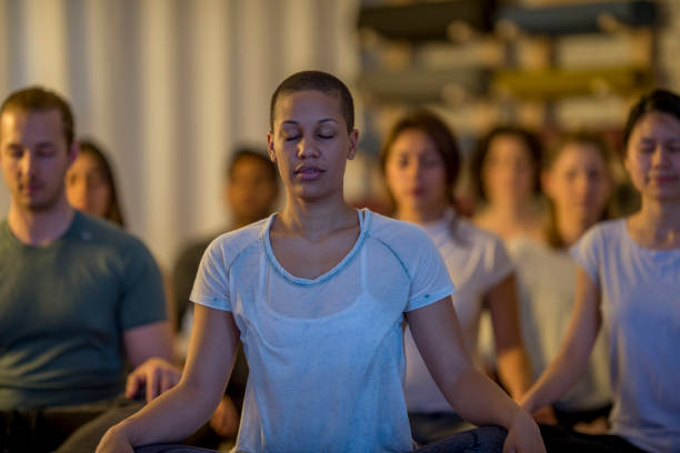 group meditation - mindfulness stock photos and pictures