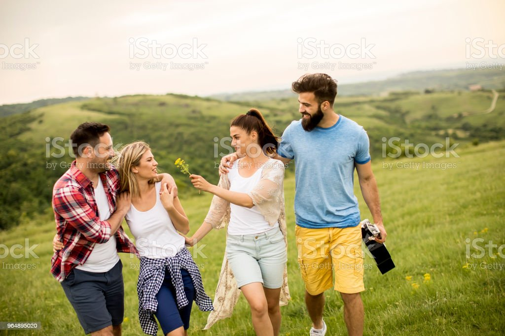 Group od young people having fun on a trip in nature royalty-free stock photo