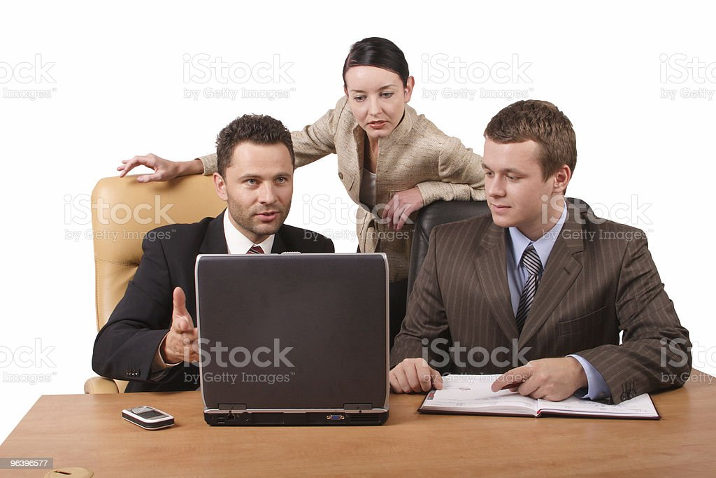 Group of 3 business people working together  with laptop - Royalty-free 25-29 Years Stock Photo