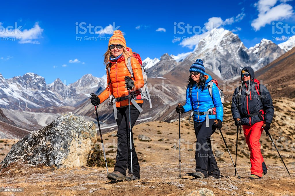 Group of 3 trekkers in Mount Everest National Park, Nepal stock photo