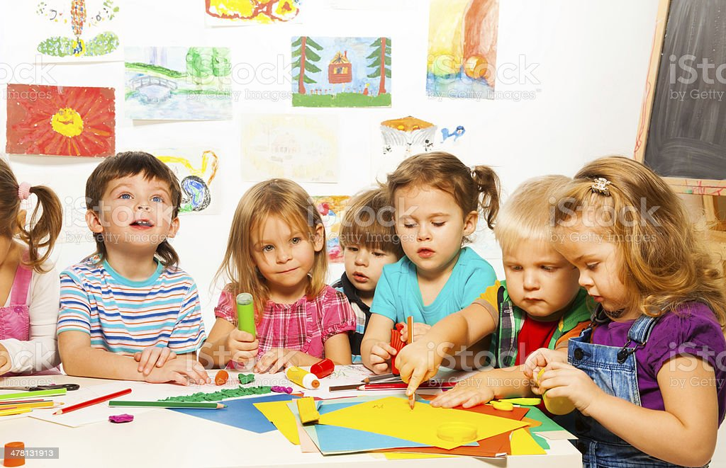 Group of 6 kids on creative class stock photo