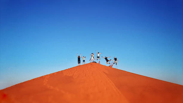 Group of 7 Red Sand dune jump stock photo