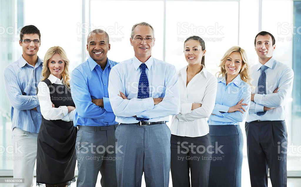 Group of a businesspeople standing together. stock photo