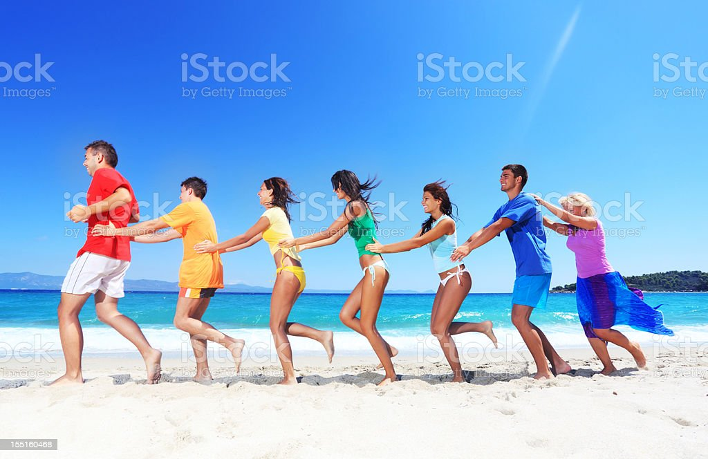 Group of a people having fun on the beach. royalty-free stock photo