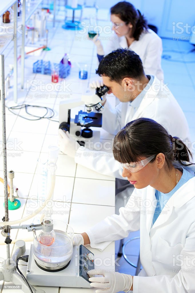Group of a scientists working in laboratory. royalty-free stock photo