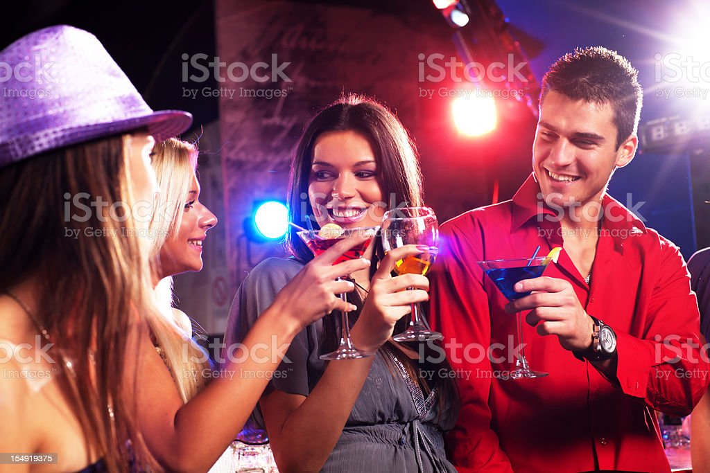 Group of a young people enjoying in cocktails. royalty-free stock photo