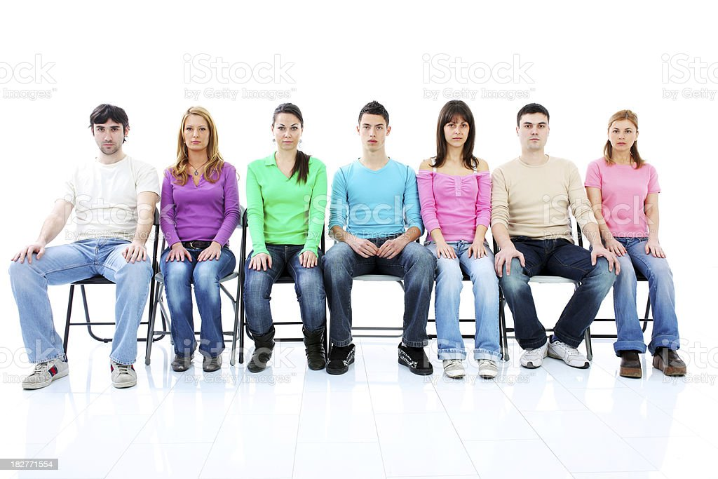 Group of a young people sitting and looking at camera. royalty-free stock photo