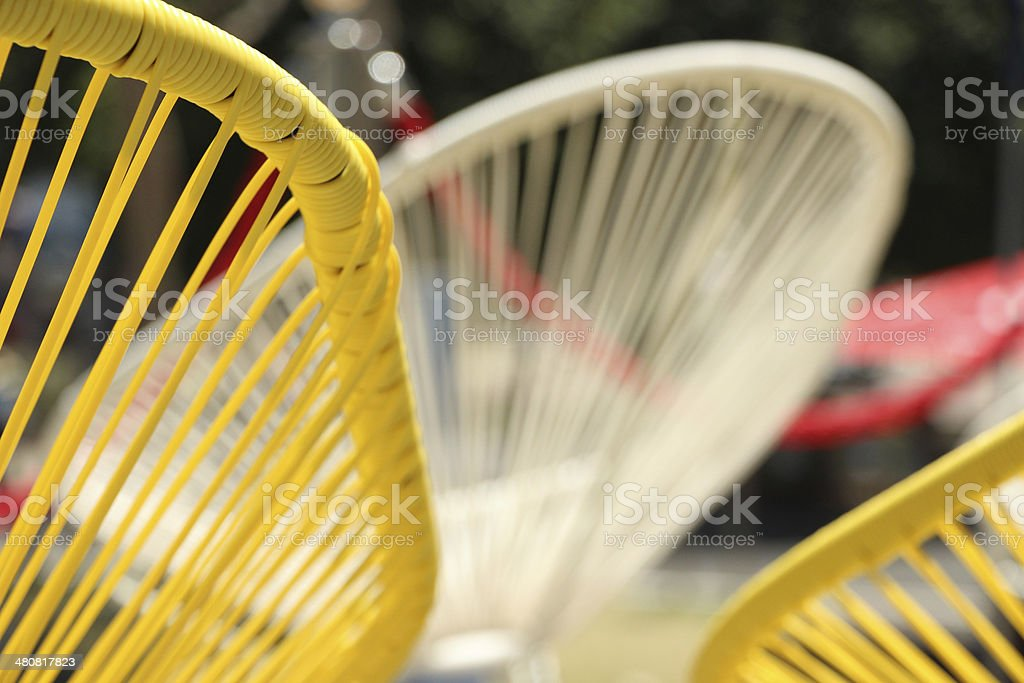 Group of Acapulco chairs - close up of detail stock photo