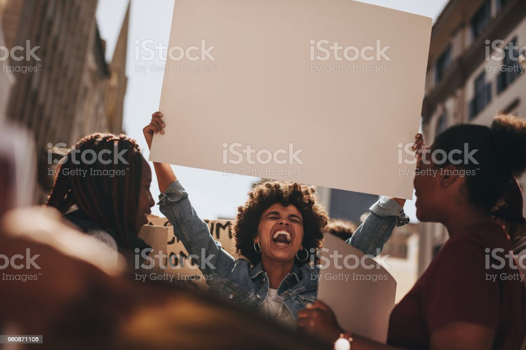 Group of activist demonstrating on road stock photo