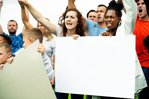 istock Group of activists are protesting 1074152576