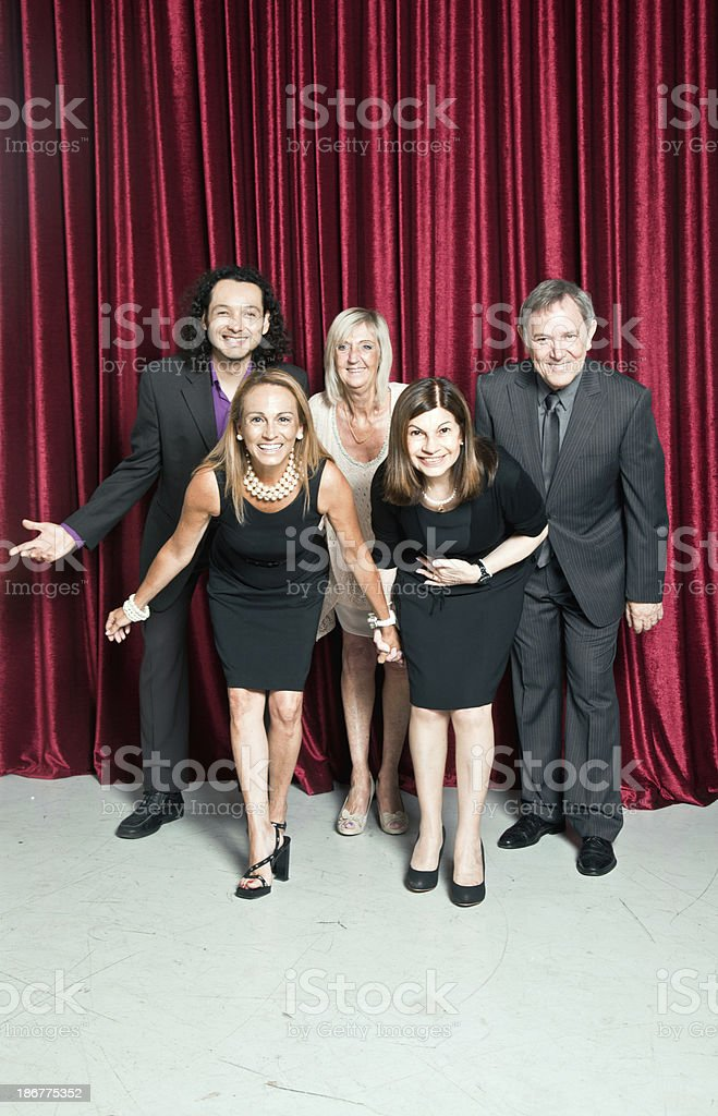 Group of actors bowing stock photo
