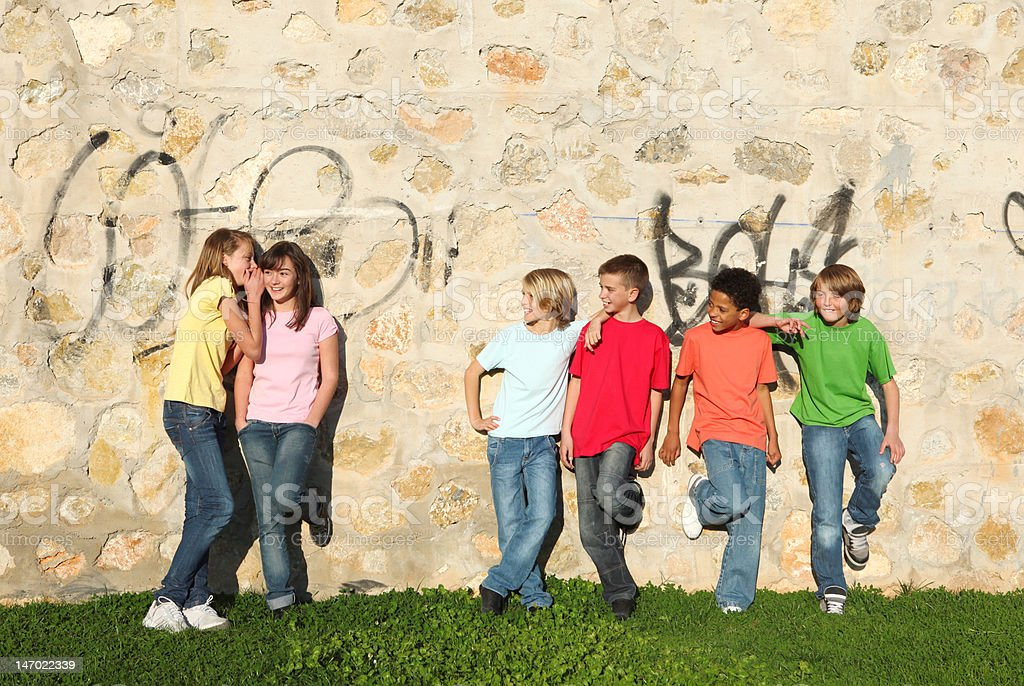 group of adolescent kids flirting royalty-free stock photo