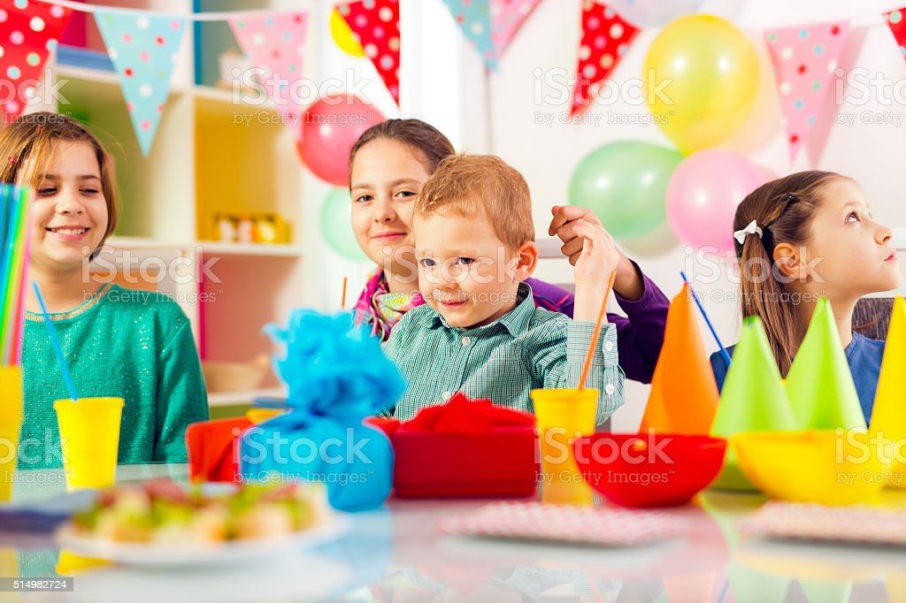 Group of adorable kids having fun at birthday party, stock photo