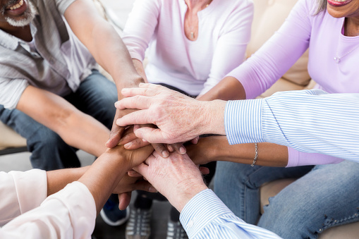 istock Group of adult hands stacked in unity 944221214
