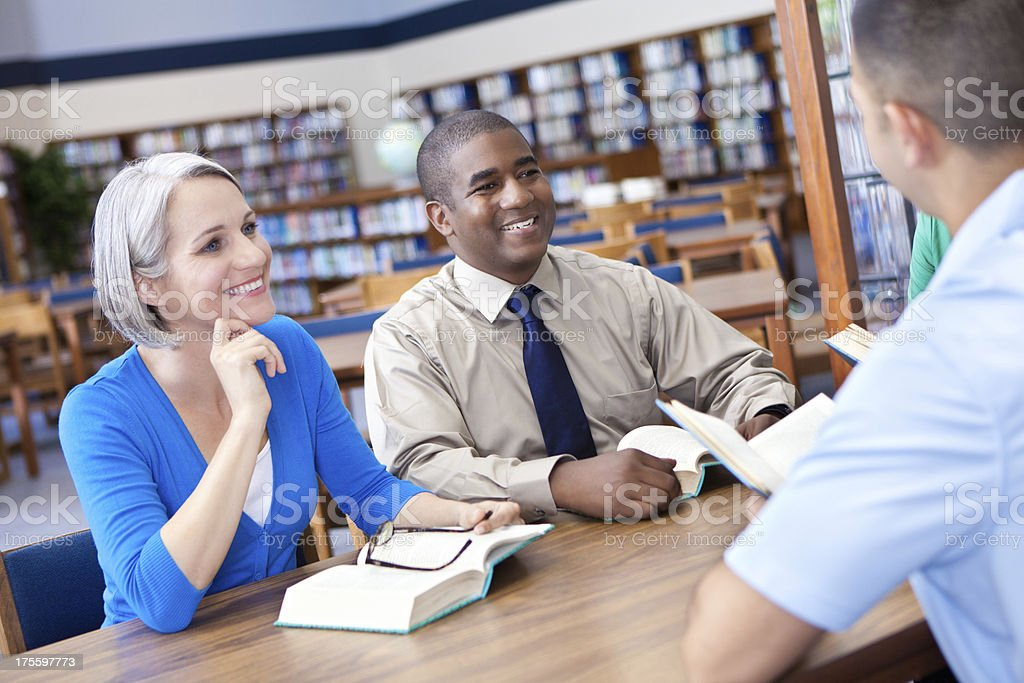 Group of adults enjoying book study together royalty-free stock photo