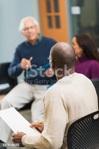 istock Group of adults having discussion 537816543